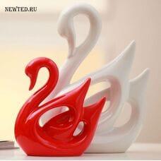 Красный и белый лебедь
