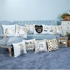 Декоративные подушки бело-бронзового цвета