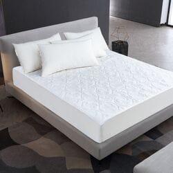 Наматрасник на кровать